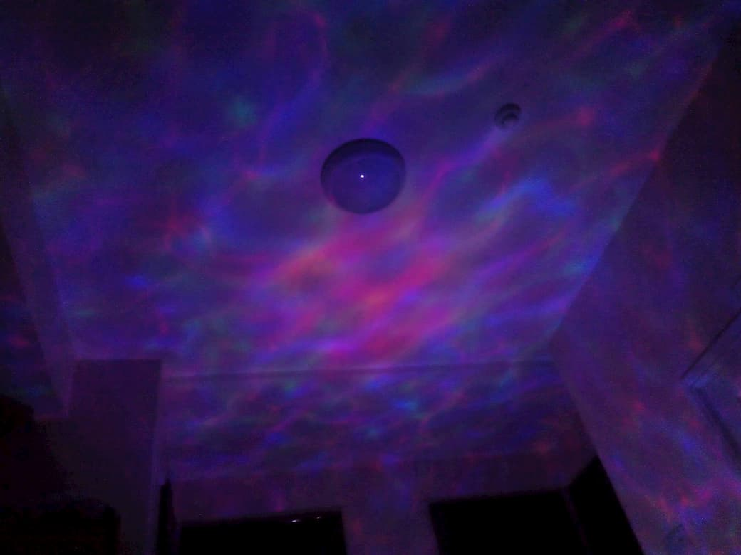 multi-coloured wave pattern. projected onto a ceiling.
