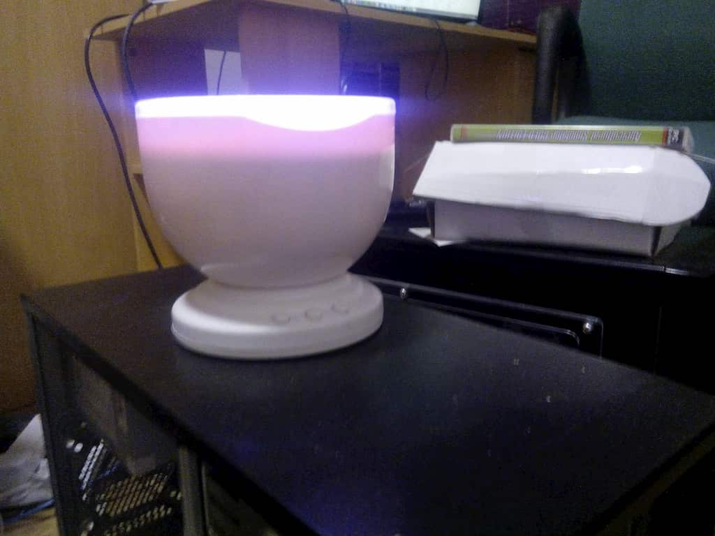 Aurora master Wave. bowl shaped device on top computer case.